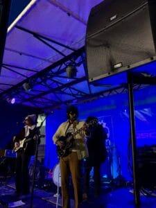 band performing using QSC KLA12 stacked loudspeakers