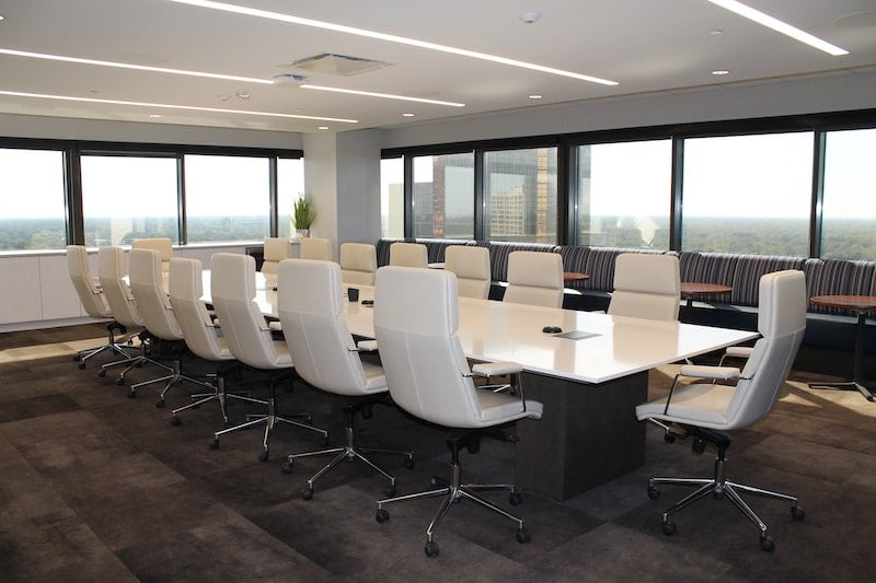 empty conference room with clean look and white table and chairs