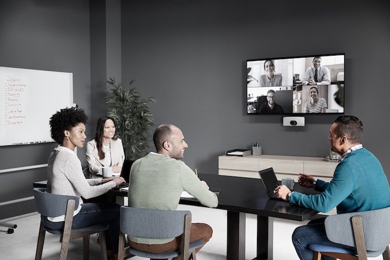 employees working in modern meeting room with video conference capabilities
